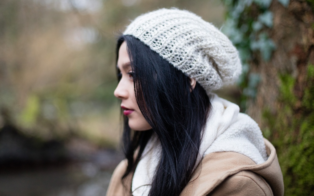Girl with white hat in profile