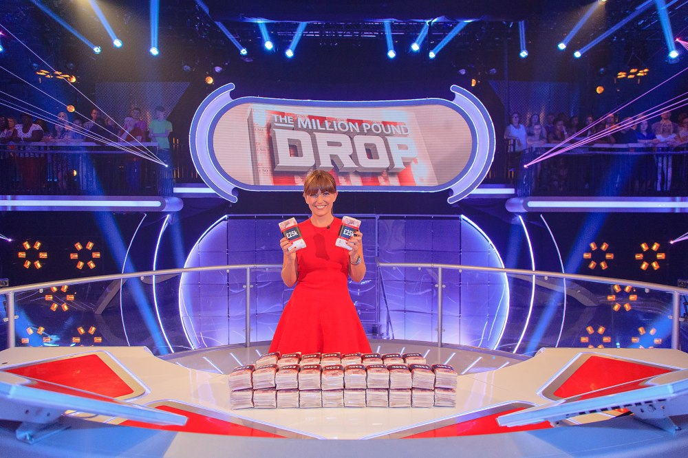 Million Pound Drop portrait of Davina Mccall posing with money in hand