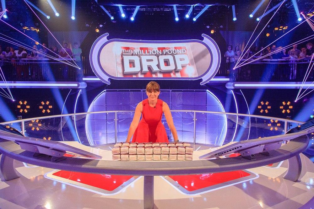 Million Pound Drop portrait of Davina Mccall posing with money