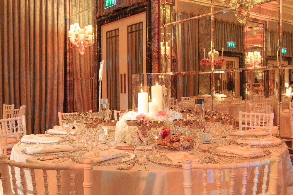 Classy production lit ballroom dressed for wedding