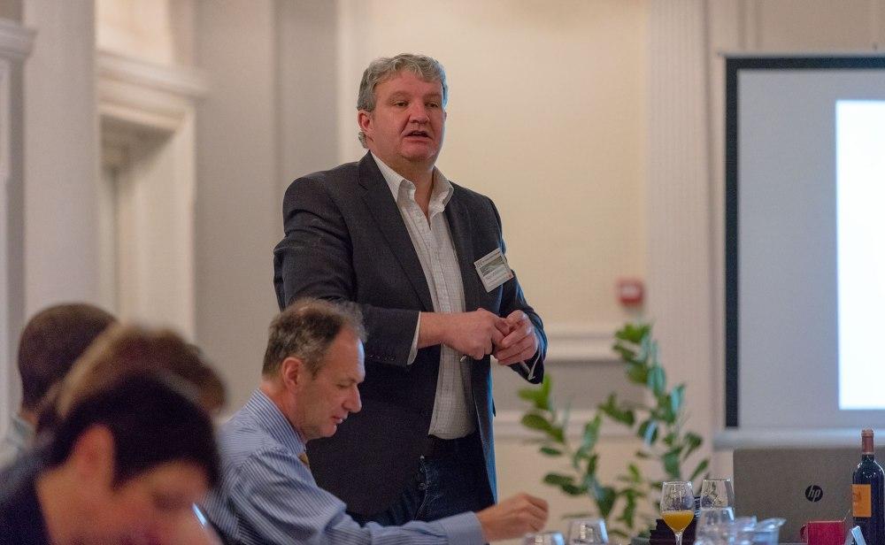 Businessman giving speech at meeting