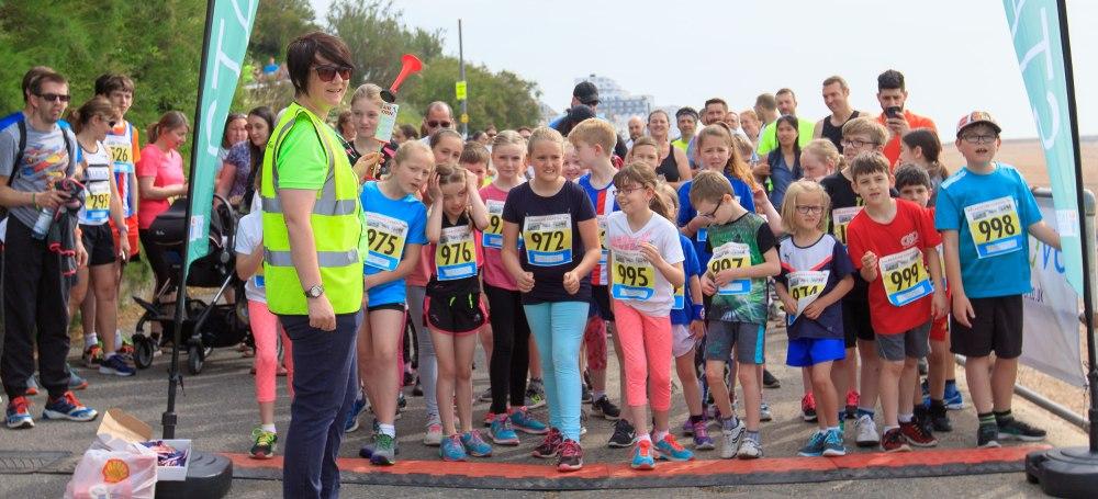 multi-coloured running attire on children starting a race
