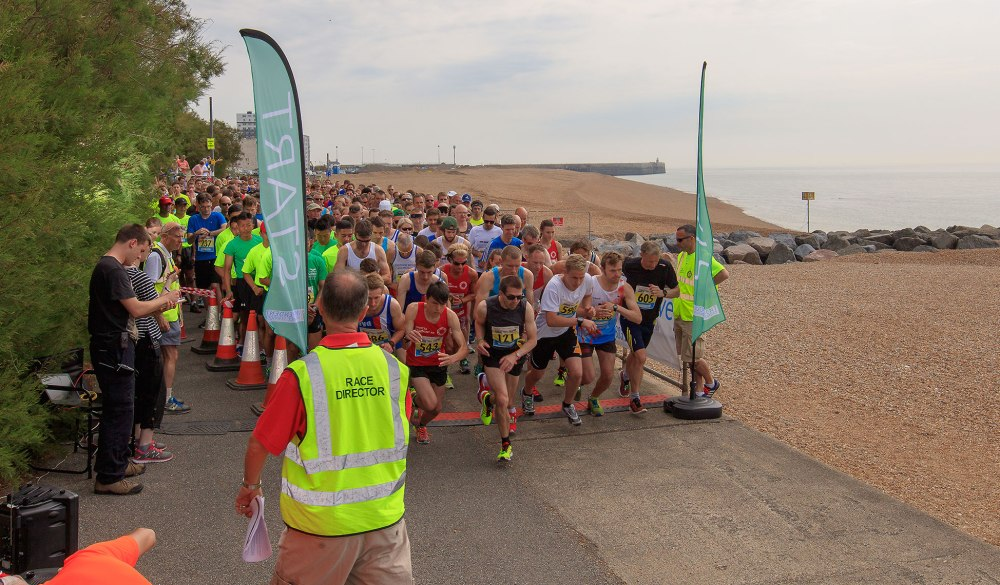 runners starting a 10 k race along the coast of southern england