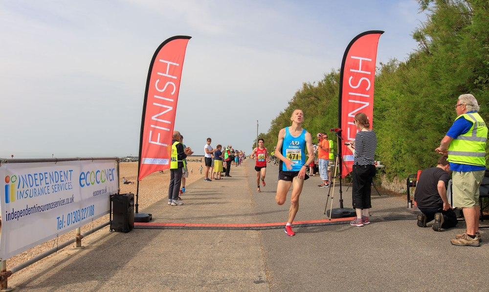 winning runner finishing 10 k race