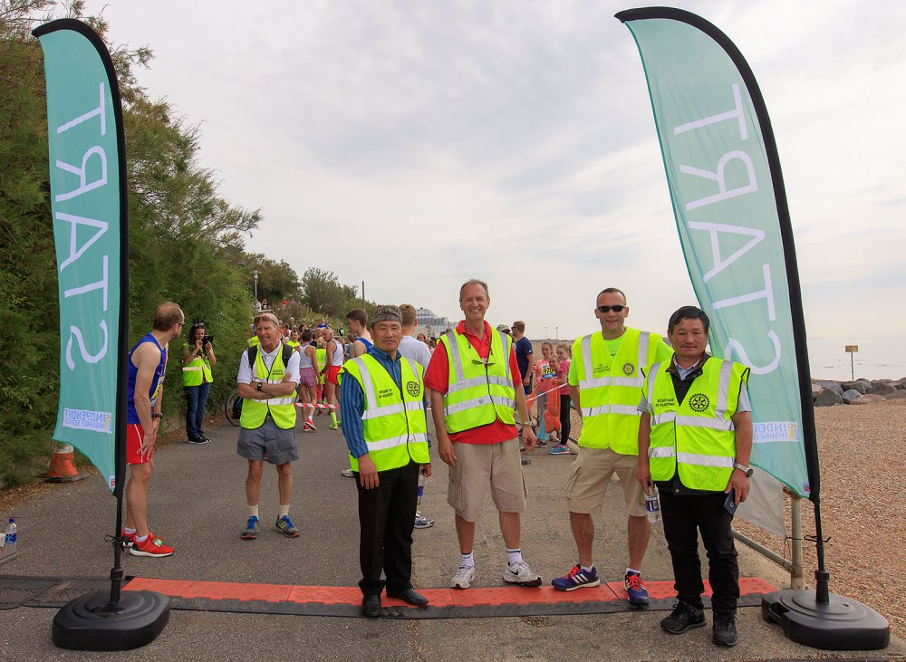 organizers of race standing for photo at the start line
