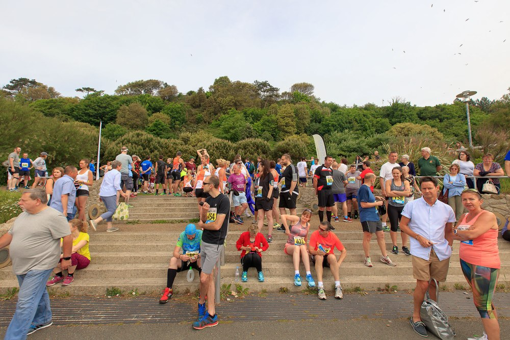 spectators of race sitting on steps